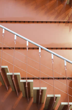 Wooden stairs and red metal, detail of a staircase inside an industrial building photo