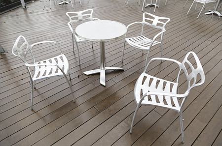 Metal chairs and table on a terrace, detail of a terrace to relax outside, urban relax