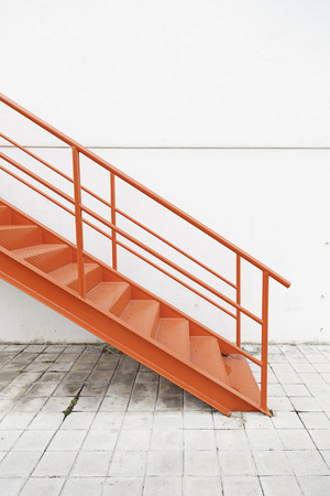 Red Metal Stairs On The Outside, Detail Of A Staircase On A Facade In An