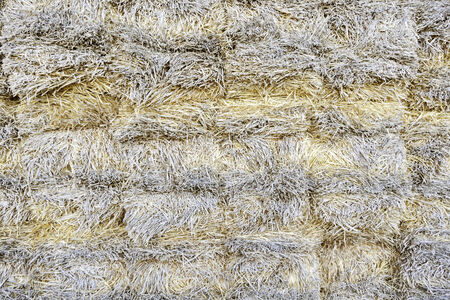 Hay Mountain, detail of a bale of straw on a farm, grain textured background photo