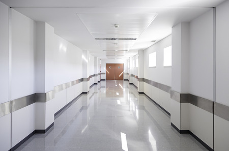 Deep hospital corridor, detail of a white corridor in a hospital, architecture and health photo