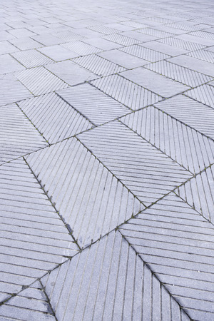 Tiled City, detail from a floor Blados a street in the city, decoration and safety photo