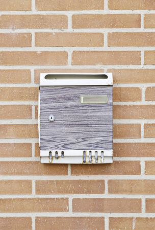 Mailbox in the wall, detail of an object to cast cards photo