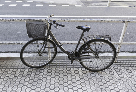 Bicycle parked in the city, detail of a publishing vehicle for city traffic, sport and environment photo