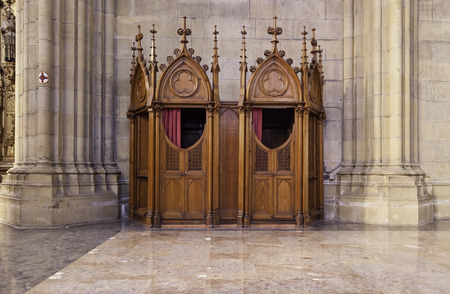 Confessional in a Catholic church, a Romanesque church detail inside