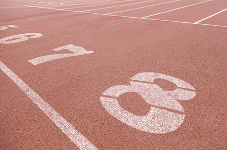 Numbers on a running track, detalle de unos números en la salida de una pista para correr, deporte y salud