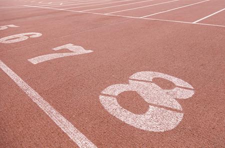 Numbers on a running track, detalle de unos n�meros en la salida de una pista para correr, deporte y salud photo