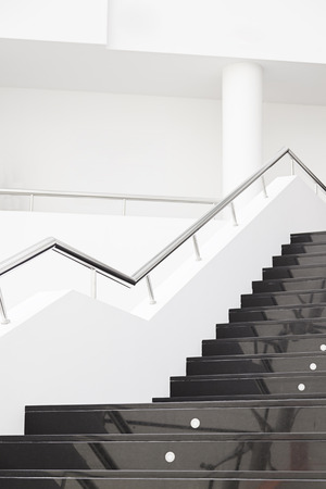 Black marble stairs, detail of the interior of a modernist building, modern architecture photo