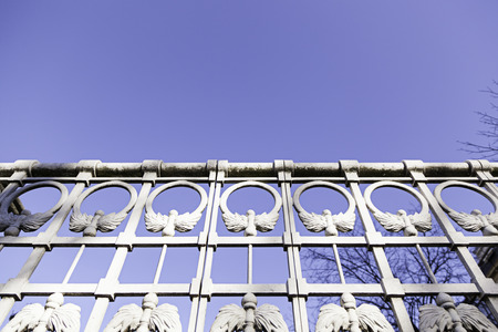 White metal railing, detail of a guardrail and decoration, exterior and sky photo