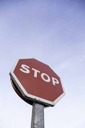 Stop sign outdoors, detail of an information signal in a highway traffic signal photo