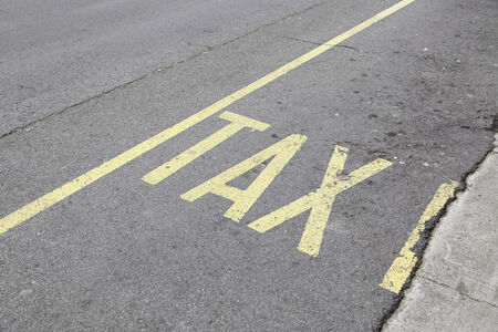 Taxi sign painted on asphalt, detailed information signal on the road, public transport photo
