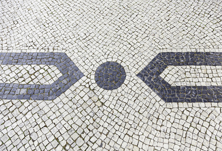 Lisbon typical mosaic, detail of a typical floor of Portugal, decorative mosaic on a typical street of Lisbon photo