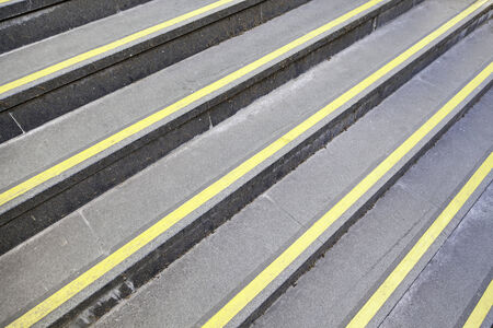 Steps with yellow signs, detail of stairs with protective signals photo