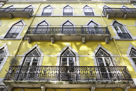 sidewall: Old yellow facade, detail of an old house painted yellow, Lisbon, Portugal