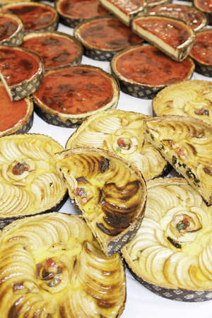 Apple pies in a market, a detail of homemade cakes in a traditional market in the city, baked sweet photo