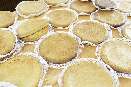 Typical Spanish cream homemade pie, a sweet dessert detail of artisan food in a street market Stock Photo