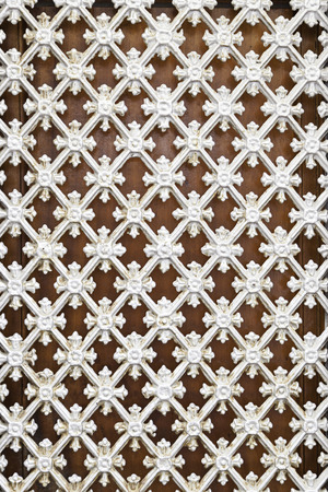 White metal fence, detail of a grille protection with decoration, security photo