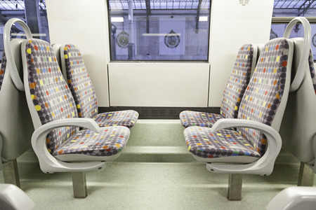 Seats on a train, detail of a new public transport, modernity and progress