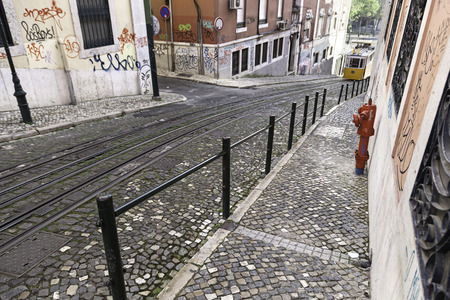 elevador: Tram on a street in Lisbon, detail of an old city transport, and tourism monument