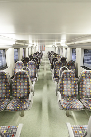 Seats on a train, detail of a new public transport, modernity and progress photo