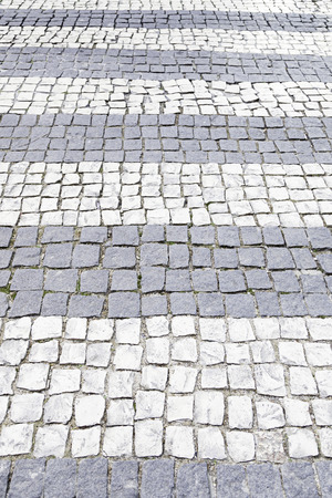 Typical stone floor Lisbon, detail of a typical floor with shapes and drawings, art Portugal, tourism photo