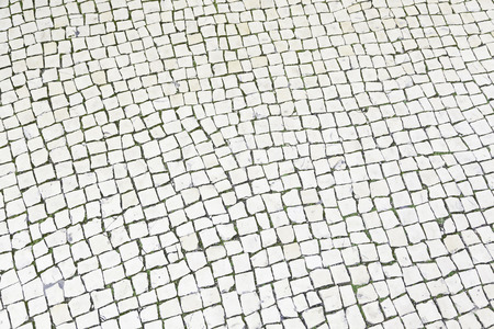 Floor typical Lisbon, detail of a typical soil in Portugal, ancient streets in the city photo