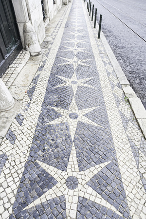 Typical stone floor Lisbon, detail of a typical floor with shapes and drawings, art Portugal, tourism