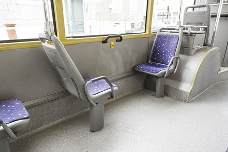 Seating inside a tram, detail of a public transport in the city photo