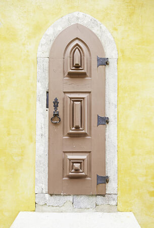 Old wooden door in Sintra, detail of a palace in a decorated door Portugal, architecture, tourism