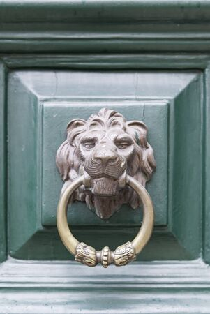 caller: Caller shaped golden lion, detail of an ancient decorated door, ancient art