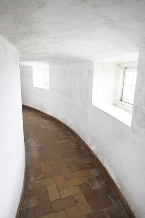 Old corridor with windows, detail of a hall in ancient catacombs