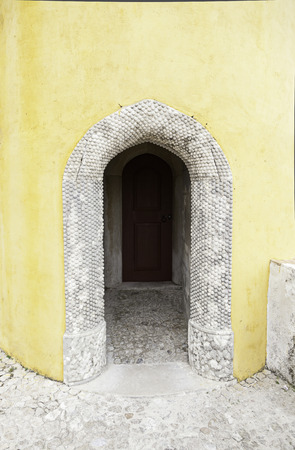 Old wooden door in Sintra, detail of a palace in a decorated door Portugal, architecture, tourism photo