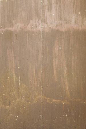 Rusty metallic background with texture, detail of a wall in disrepair, rusty metal photo