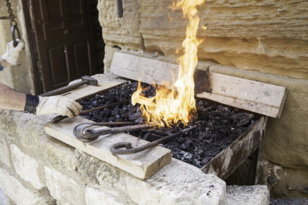 forge: Flames in a forge, a forge detail for shaping metals, craftsmanship