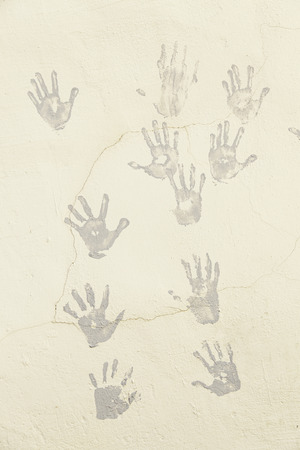 handprints: Hand painted on a wall, detail of a wall decorated with hands