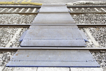 Railroad tracks, roads in some detail a station, overland transport photo