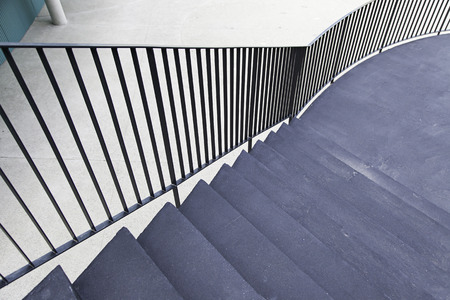 Black cement staircase, detail of a staircase on the outside of a house photo