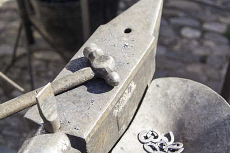 forge: Hammer and anvil forge, detail of a workshop for shaping metal