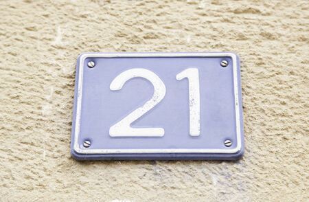 cast metal type: Number twenty one on a wall, detail of a number of information, odd number