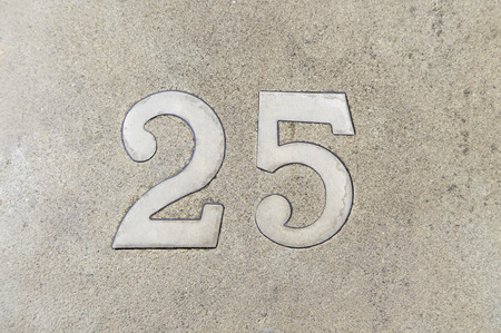 factorial: Number twenty in a wall of a house, detail of a number of information, odd number