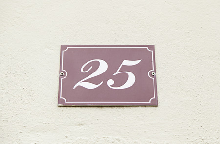Number twenty in a wall of a house, detail of a number of information, odd number