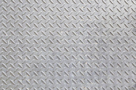 Rugged metallic background with embossed detail of a metal skid bottom Stock Photo
