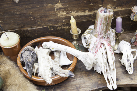 Objects for spells and witchcraft, detail of a table for witchcraft photo
