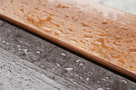 Wood wet with water, wood detail two colors with water drops