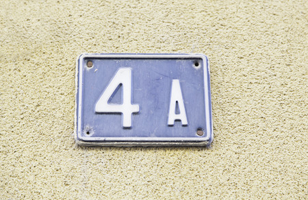 4 door: Number four on the wall of a house, detail of a number of information, even number