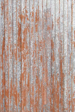 rustiness: Rusty red metal door, detail of an old door and abandoned