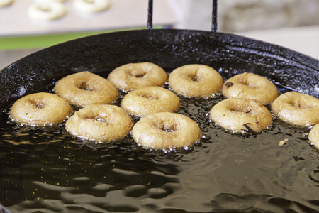 Frying donuts in a market, detail of a kitchen, sweet dessert