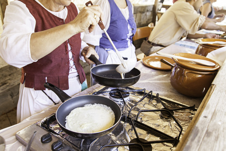 cook griddle: Cooking pancakes on a fair, detail of a position in a market, healthy food, party