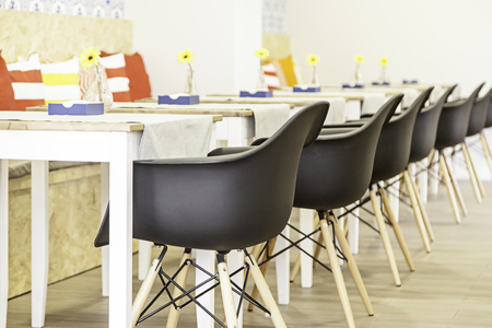 sunroom: Tables and chairs for breakfast, detail of a sunroom Stock Photo