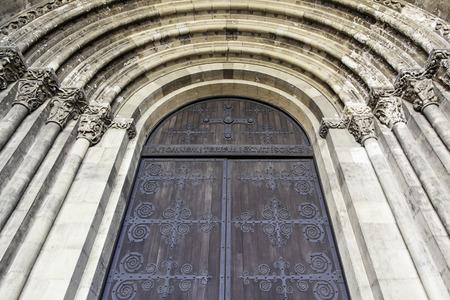 Old church facade, detail of an arc of a church, religious art Stock Photo